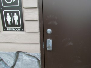 Bear paw prints on outhouse door