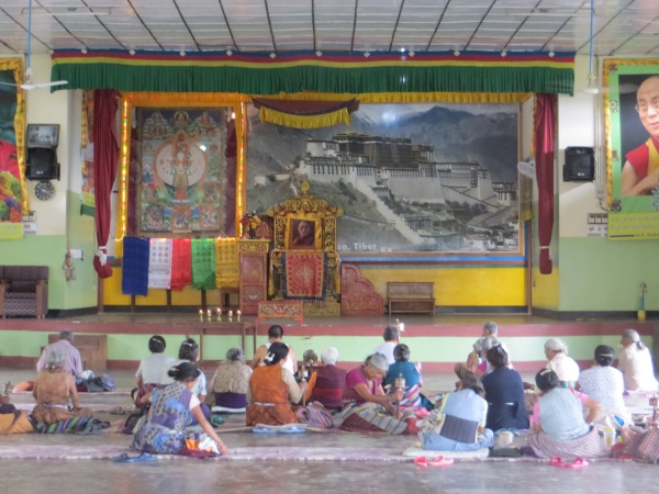 Tibetan refugees praying