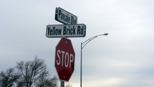 Yellow brick road sign